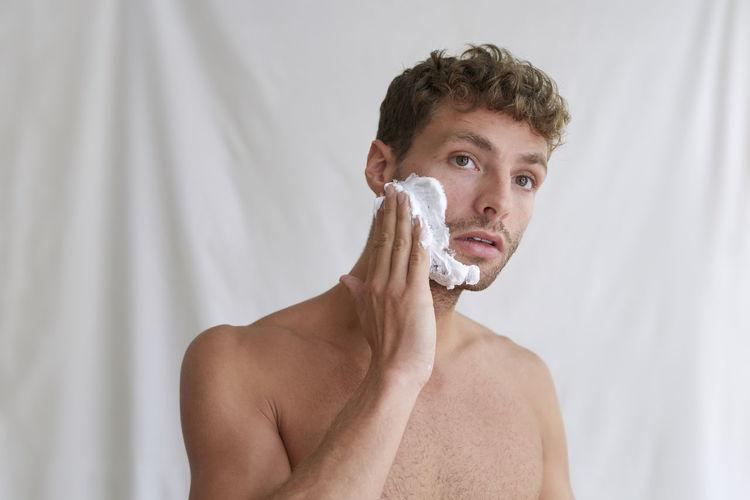 Portrait of handsome young man in bathroom