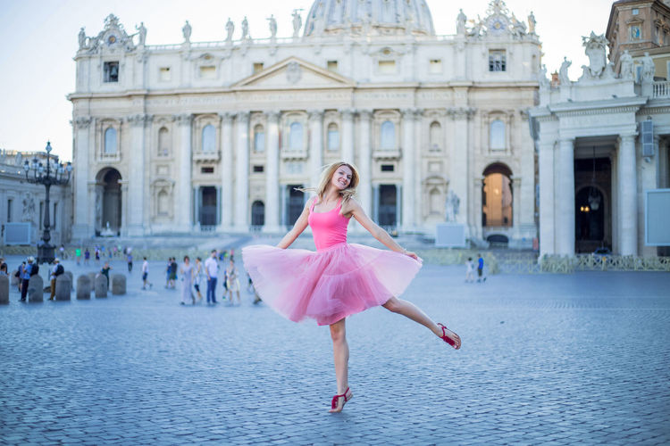 Woman Dancing In Front Of Building