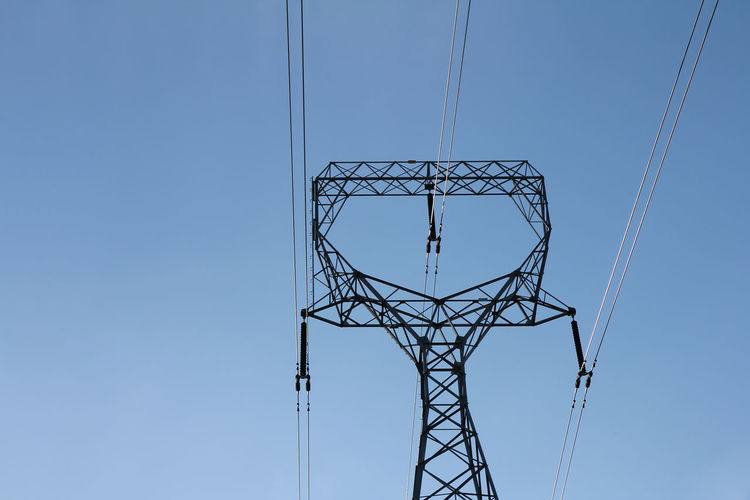 Architecture Blue Built Structure Cable Clear Sky Complexity Connection Copy Space Day Directly Below Electrical Equipment Electricity  Electricity Pylon Fuel And Power Generation Girder Low Angle View Metal Nature No People Outdoors Power Line  Power Supply Sky Technology