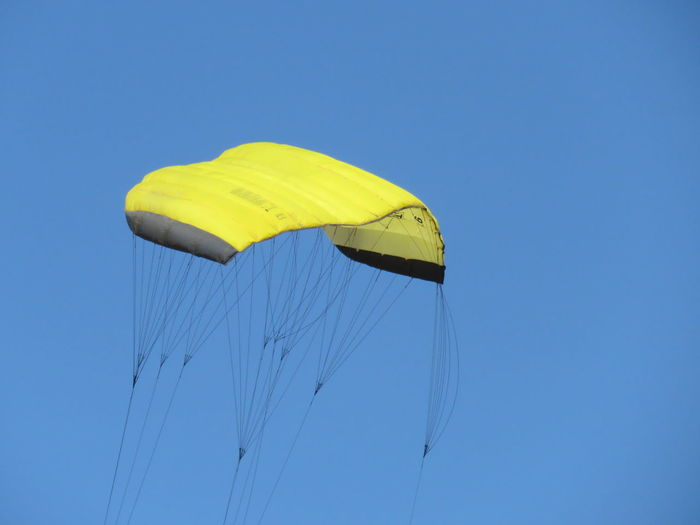 Low angle view of parachute against clear sky
