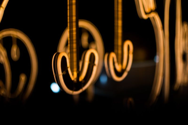 Illuminated Night No People Text Close-up Communication Indoors  Glowing Swirl Orange Color Panoramic Yellow Dark Creativity Selective Focus Gold Colored Long Exposure Luminosity Black Background Focus On Foreground