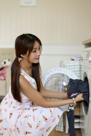Doing Laundry Laundry Laundry Day Washing Machine One Person Indoors  Young Adult Lifestyles Laundry Young Women One Young Woman Only