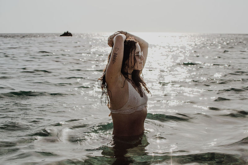 Summer in Sardinia Holiday Relaxing Summertime Woman Beach Beautiful Woman Bikini Day Horizon Over Water Nature Ocean One Person Outdoors Playing Real People Relax Sea Sea And Sky Sky Splashing Summer Sunset Swim Water Young Woman The Portraitist - 2018 EyeEm Awards