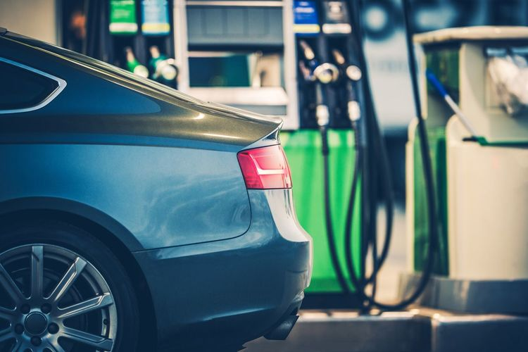 Cropped image of car at gas station
