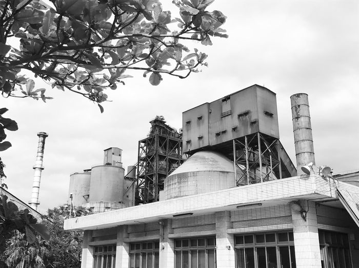 Architecture Built Structure Building Exterior Low Angle View Tree Outdoors Bad Factory Factory WTF Sky No People Branch City