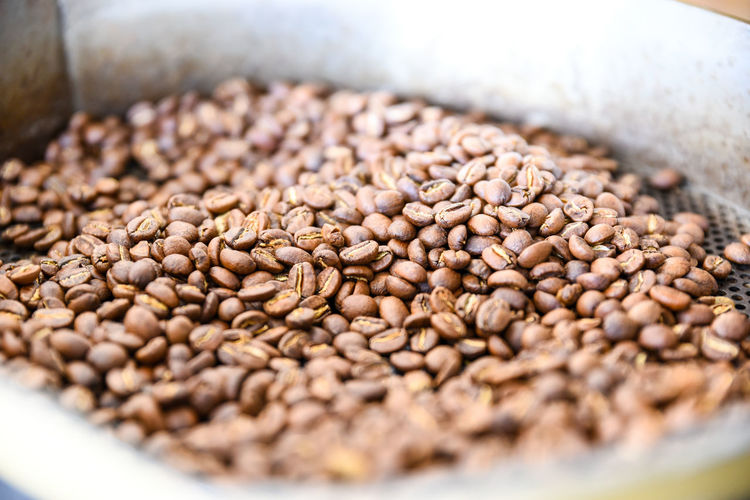 Close-Up Of Roasted Coffee Beans In Colander