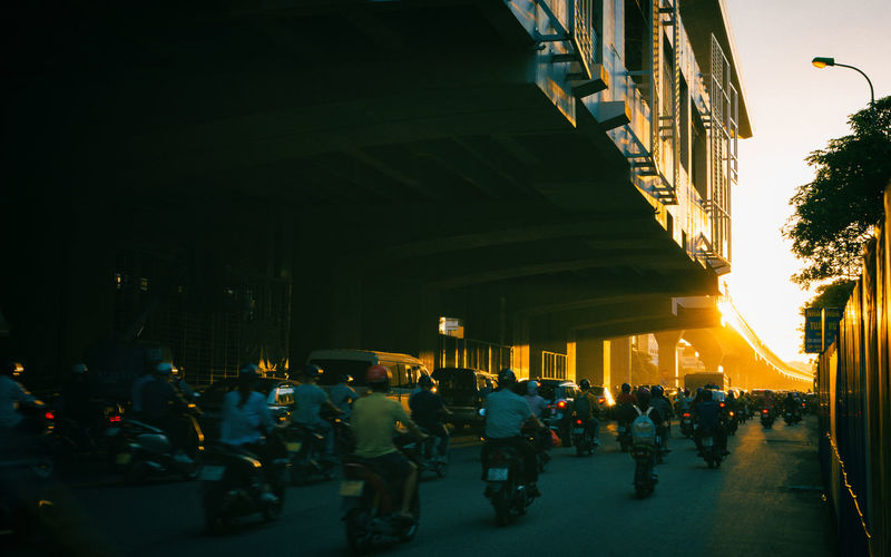 Group of people on road in city