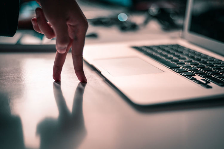 Close-Up Of Businesswoman Hand By Laptop In Office
