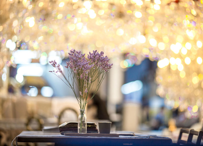 Close-up of flower vase on table in restaurant