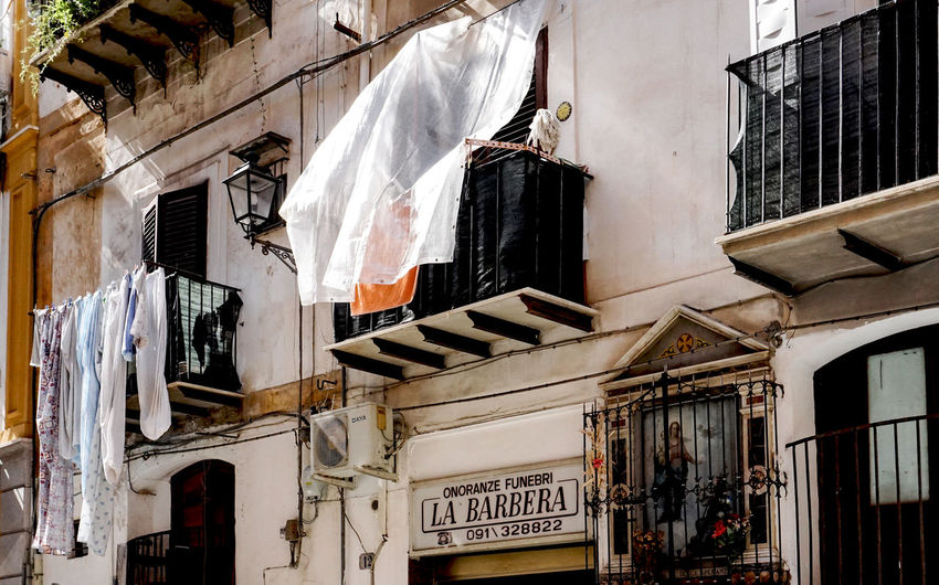 facade with barber shop in Palermo, Sicily Travel Destinations Travel Palermo Barbera  Barber Balconies Statue Holy Low Angle View Laundry Drying Hanging Window Clothesline Textile Balcony No People