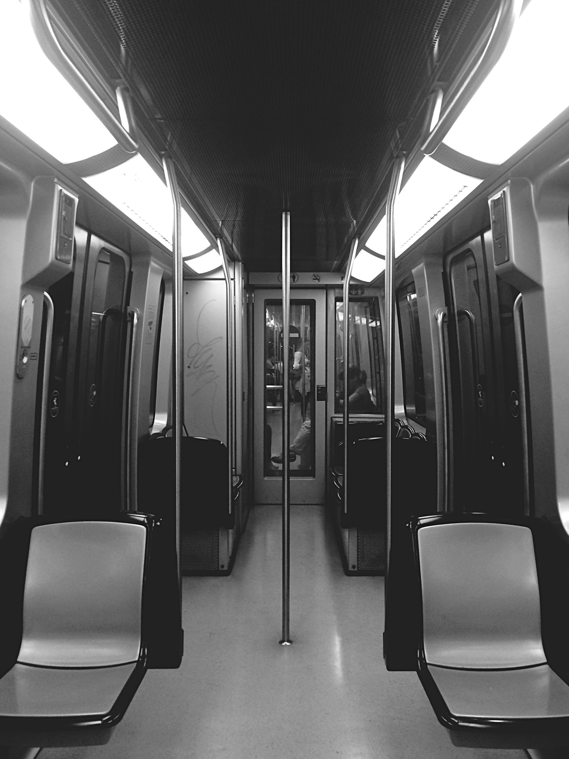 indoors, empty, absence, vehicle seat, transportation, chair, public transportation, interior, seat, vehicle interior, window, mode of transport, travel, in a row, train - vehicle, modern, ceiling, public transport, no people, passenger train
