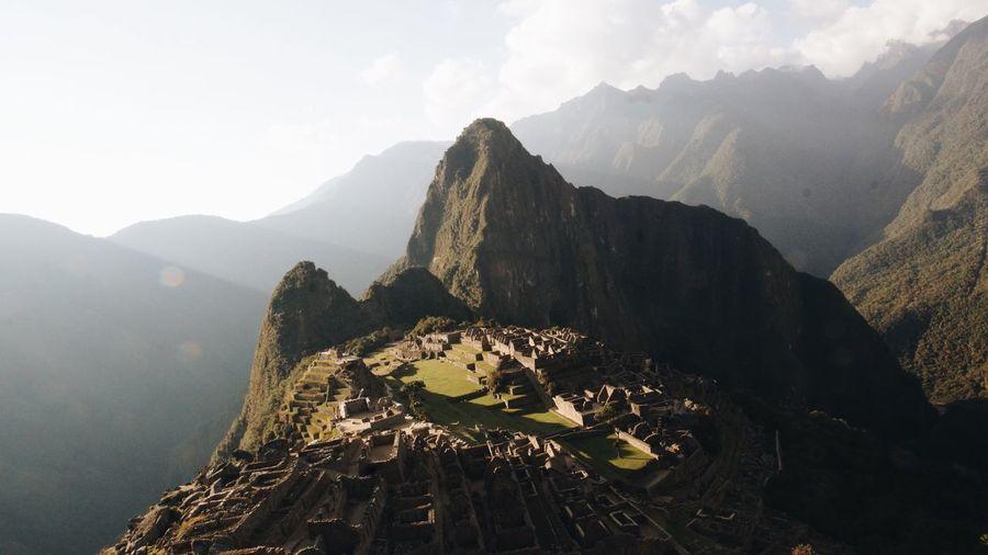 Machu picchu by rocky mountains against sky