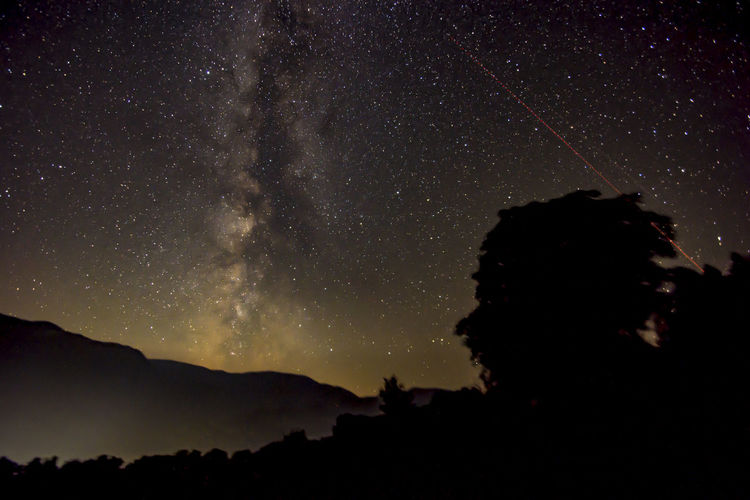 Astronomy Beauty In Nature Galaxy Milky Way Mountain Nature Night Nightflight No People Outdoors Scenics Silhouette Sky Space Space And Astronomy Star - Space Star Field