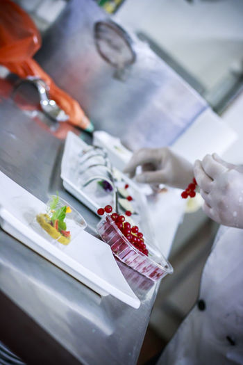 Cropped image of chef preparing food in restaurant