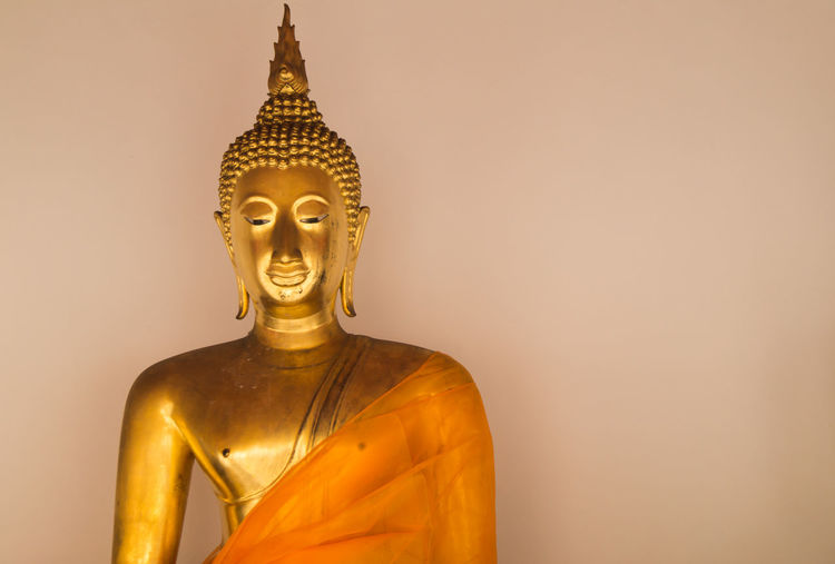 portrait gold buddha statue in wat po bangkok thailand Religion Statue Belief Human Representation Spirituality Sculpture Art And Craft Representation Gold Colored Gold Male Likeness Place Of Worship Indoors  Studio Shot Architecture Copy Space Creativity Gilded Idol Buddha Statue Gold Buddha Statue Gold Buddha Wat Pho Bangkok Thailand. Portrait