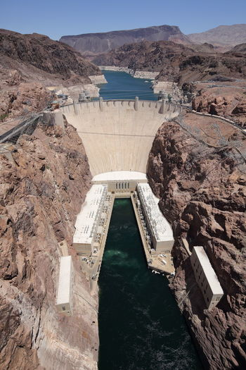 Wide angle view of hoover dam looking from the bypass bridge