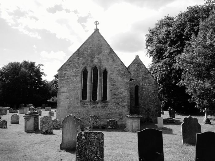 United Kingdom England Malmesbury Tombstone Grass Sky Cloud - Sky No People Tree Outdoors Cross Day Built Structure Architecture Church Cemetery Black & White Old Vintage Gravestone Memorial Graveyard The Past Sadness Spirituality Religion Nature