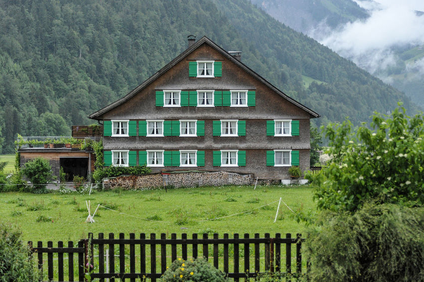 Architecture Bizau Building Exterior Clouds Exterior Fence Grass Historic House Human Settlement Lawn Mountains Nikon 28-300 Nikon D3s Old Buildings Outdoors Roof Rural Rural Building Vorarlberg  Windows Wooden Woodcut Holzschindeln Nikonphotography