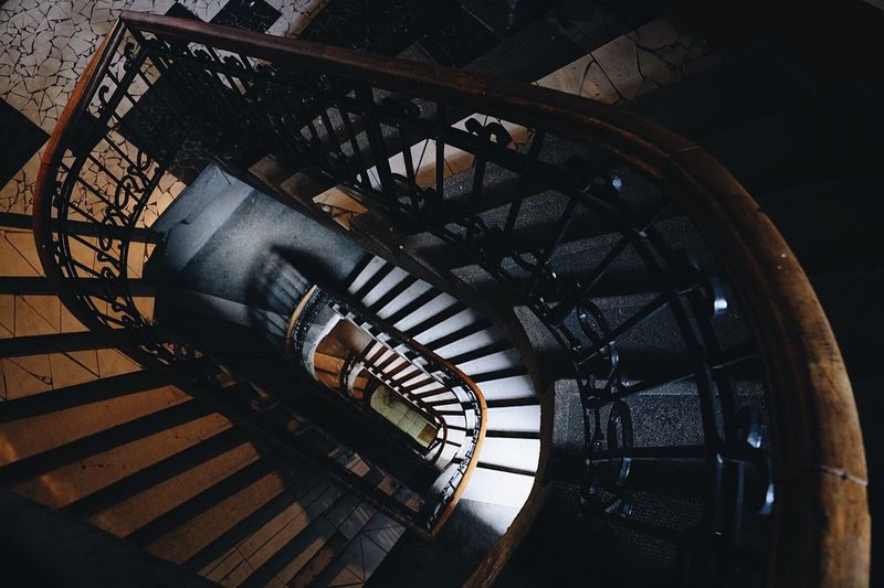Stairs Stairs EyeEm Selects Staircase Steps And Staircases Architecture Spiral Spiral Staircase Indoors  Built Structure Railing High Angle View No People Pattern Day Building Sunlight Wood - Material Metal Directly Above Absence Design Directly Below
