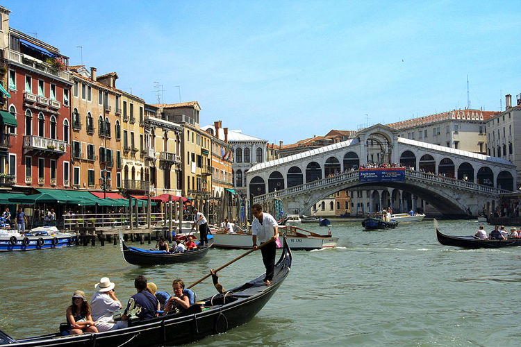Gondalas and the Rialto Bridge - Venice, Italy Architecture Bridge - Man Made Structure Building Exterior Built Structure Canal Connection Day Gondola Gondola - Traditional Boat Gondolier Large Group Of People Men Nautical Vessel Outdoors Rialto Bridge The World Before Bin Laden Tourism Transportation Travel Travel Destinations Vacations Venice, Italy Water Women