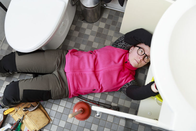 High angle view of man relaxing in bathroom