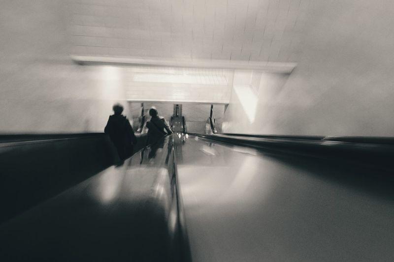 Downwards Subway Station Monochrome Blackandwhite Schwarzweiß Copy Space Motion Blur Architecture Looking Down Underground On The Move Escalator