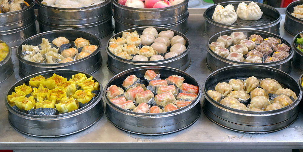 A street vendor sells Chinese dim-sum dishes cooked in metal steamers Cantonese Food Dim Sum Kaohsiung Asian Food Buns Chinese Food Dim-sum Dumplings Food Freshness Healthy Eating Hot Food Steamed Food Steamers Street Food Stuffing - Food Variety