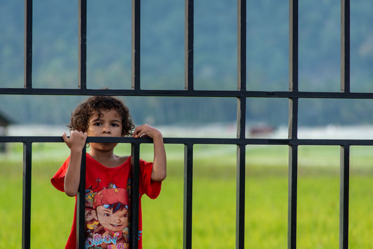 captured tomorrow Capture Tomorrow Child Childhood Portrait Window Standing Sky Preschooler Children Outdoor Play Equipment Looking Through Window Head And Shoulders Slide - Play Equipment Elementary Age Asian  Single Parent Superhero