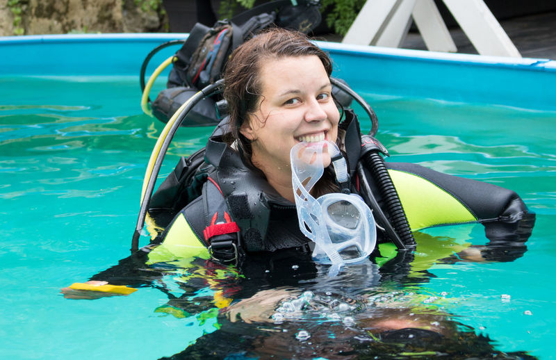 Diving Gear Diving Instructor Diving Mask Diving Sign Enjoyment Girl Power Going Down Sign Laughing Lifestyles Okay Sign Outdoor Outdoor Swimming Pool Outdoors School Scuba Diving Course Scubs Diver Teaching Diving Water