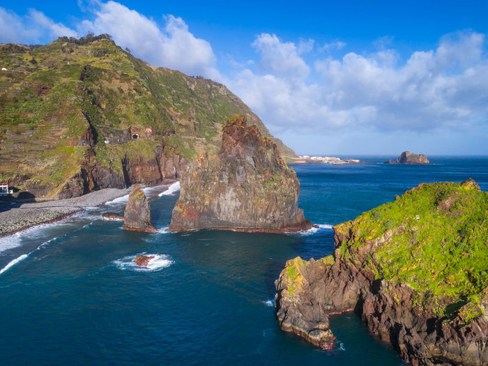 Aerial drone view of Janela Islets in Porto Moniz in Madeira Madeira Portugal Island Ilha Travel Landscape Nature Mountain Drone  Aerial View Aerial Panorama Panoramic Islet Europe European  Coastline Coast Ocean Atlantic Top Best  Outdoors Portuguese