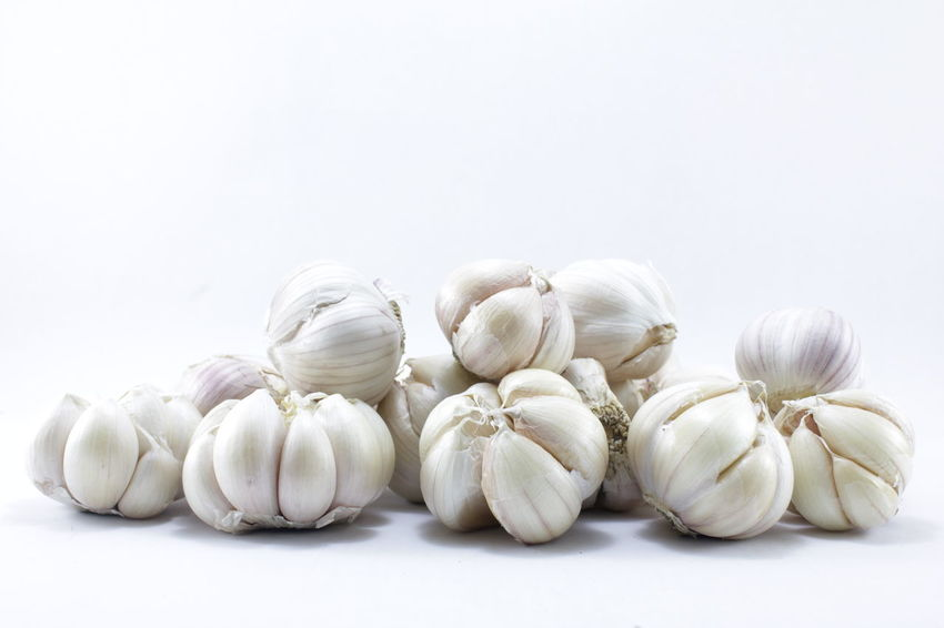 Garlic on a white background Garlic On A White Background Close-up Day Food Food And Drink Freshness Garlic Garlic Bulb Healthy Eating Indoors  No People Raw Food Studio Shot White Background White Color