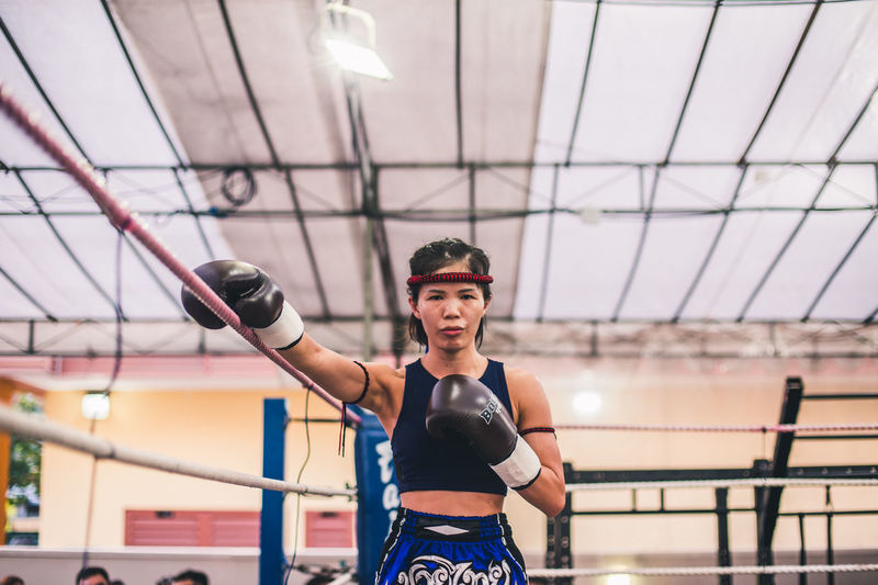 Determined. International Women's Day 2019 Lifestyles Healthy Lifestyle Sport Determination Exercising Muay Thai Fighting Looking At Camera Young Adult Portrait Young Woman Kickboxing Real People One Person Front View