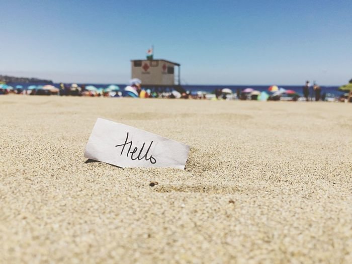 Hello Message Day Trip Incidental People Vacations Holiday Western Script Beach Travel Destinations Architecture Travel People Sand Sea Land Water Nature Sky Communication Text