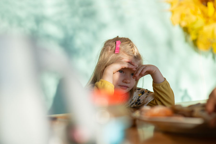 Little Girl Portrait Sitting Indoors  Table Serious Kid Child Childhood Headshot Girls Real People Blond Hair Casual Clothing Face Candid Family Time Family Lifestyle Minor Pre-school Preschooler Thoughtful EyeEm Kids