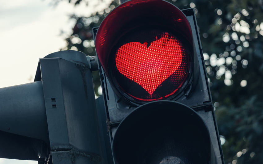 Low Angle View Of Traffic Signal Showing Heart Shape