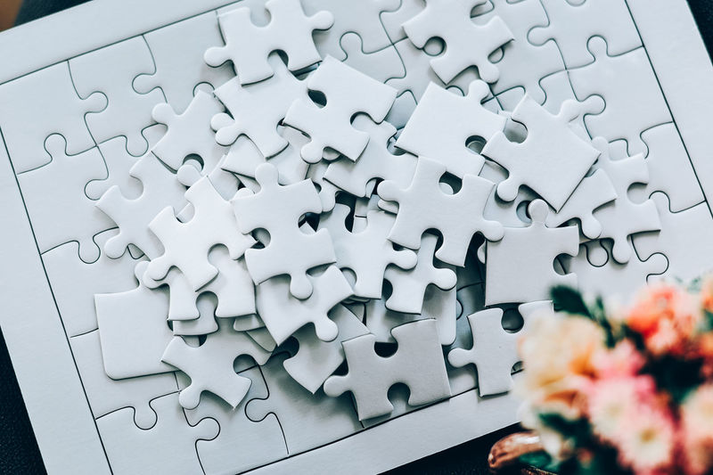 Abundance Arrangement Backgrounds Close-up Connection Flower Flowering Plant Full Frame High Angle View Indoors  Jigsaw Piece Jigsaw Puzzle Large Group Of Objects Leisure Activity No People Paper Pattern Puzzle  Solution White Color