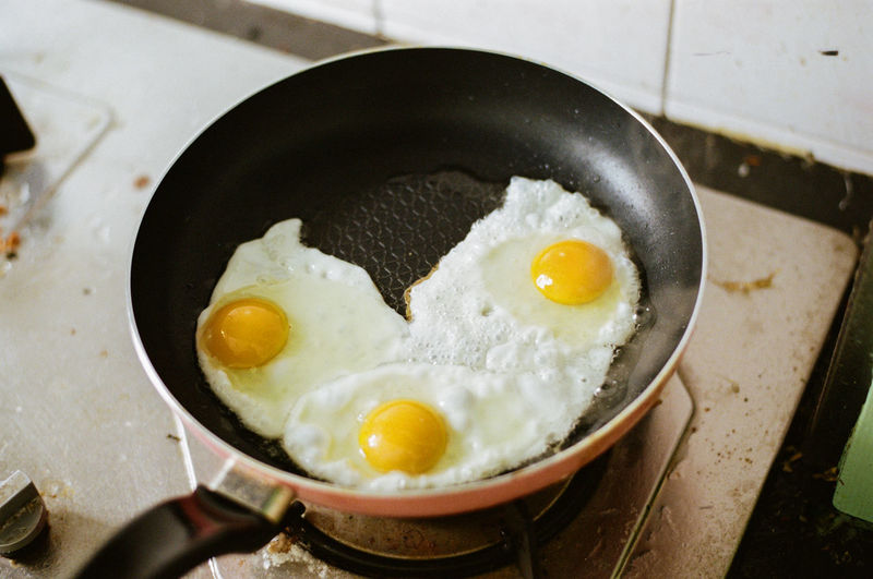 Close-up of eggs in cooking pan