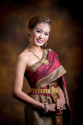 Portrait Of Female Model Wearing Sari While Standing Against Wall