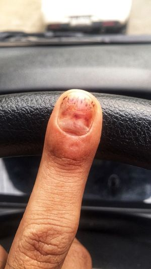 Close-up of man hand in car