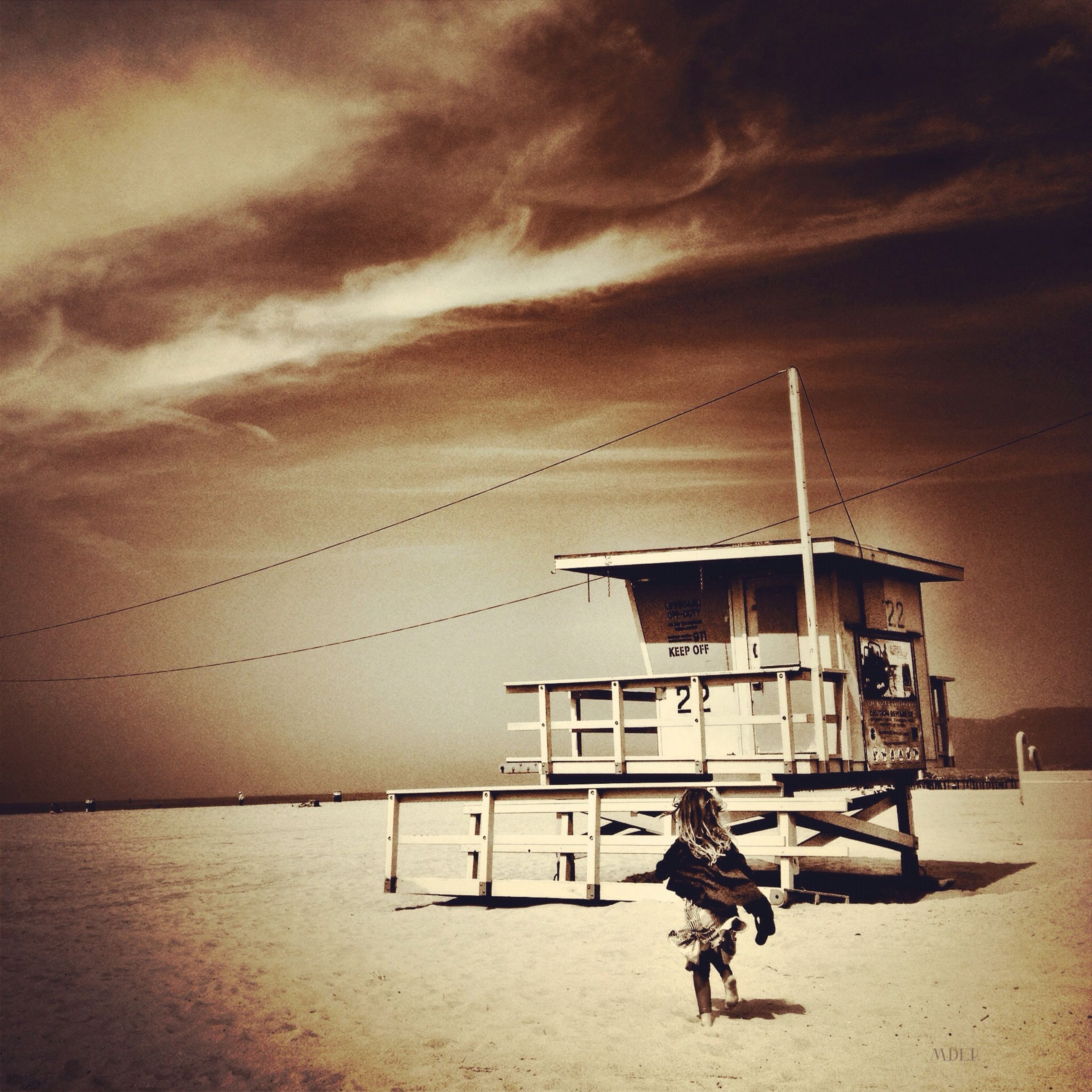 sky, cloud - sky, built structure, cloudy, architecture, building exterior, men, cloud, sunset, weather, full length, outdoors, overcast, nature, house, lifestyles, sand, day