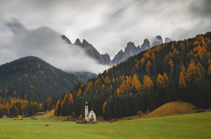 Scenic view of santa maddalena in dolomites  mountains against sky