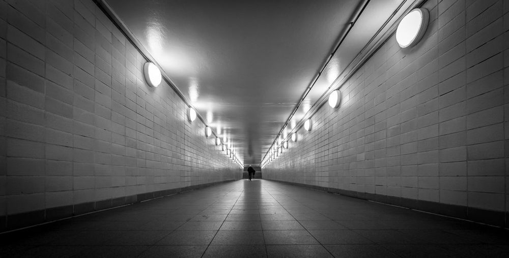 The Art Of Street Photography Black And White Street Photography City Tunnel Futuristic Illuminated The Way Forward Direction Lighting Equipment Architecture Indoors  Wall - Building Feature Diminishing Perspective Flooring Ceiling Public Transportation Transportation Footpath Tile Subway Built Structure Wall No People Electric Light Light Underground Walkway Underpass Tiled Floor Long
