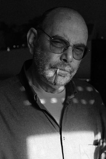 Close-Up Of Bald Man In Eyeglasses