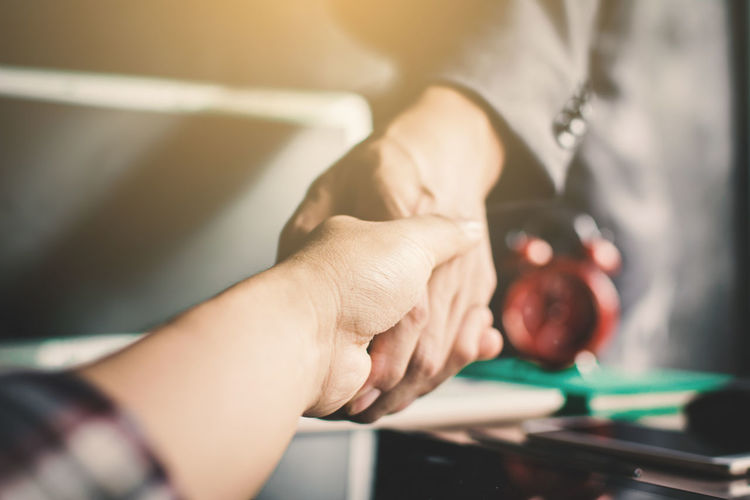 Cropped hands of business people doing handshake