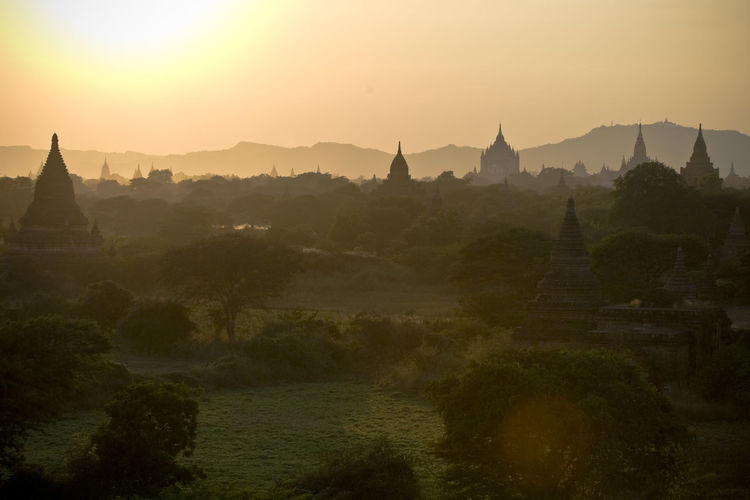 the valley of Bagan // Myanmar Architecture Built Structure Famous Place First Eyeem Photo Idyllic Landscape Mountain Mountain Range Myanmar Nature No People Orange Color Outdoors Place Of Worship Religion Scenics Spirituality Sun Sunset Temple - Building Tourism Tranquil Scene Tranquility Travel Destinations Tree