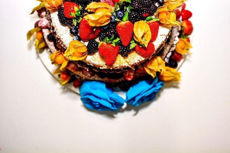 Close-Up Of Fruitcake On White Background
