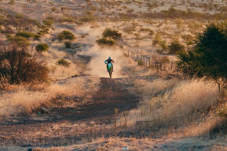 Man Cycling On Dirt Road