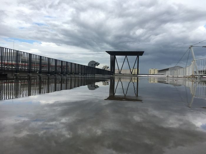 Pier over water against sky