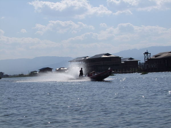 Speeding Narrow Boat Blue Sky White Clouds Boat Composition Fun Inle Lake Lake Mode Of Transport Mountain Myanmar Narrow Boat Nautical Vessel No People Outdoor Photography Ripples In The Water Shan State Speeding Boat Spray Sunlight Tourism Tourist Attraction  Tourist Destination Traditional Boat Underway Water Water Spray