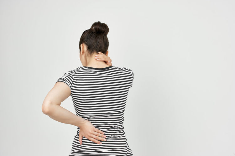 Full length of woman standing against white background